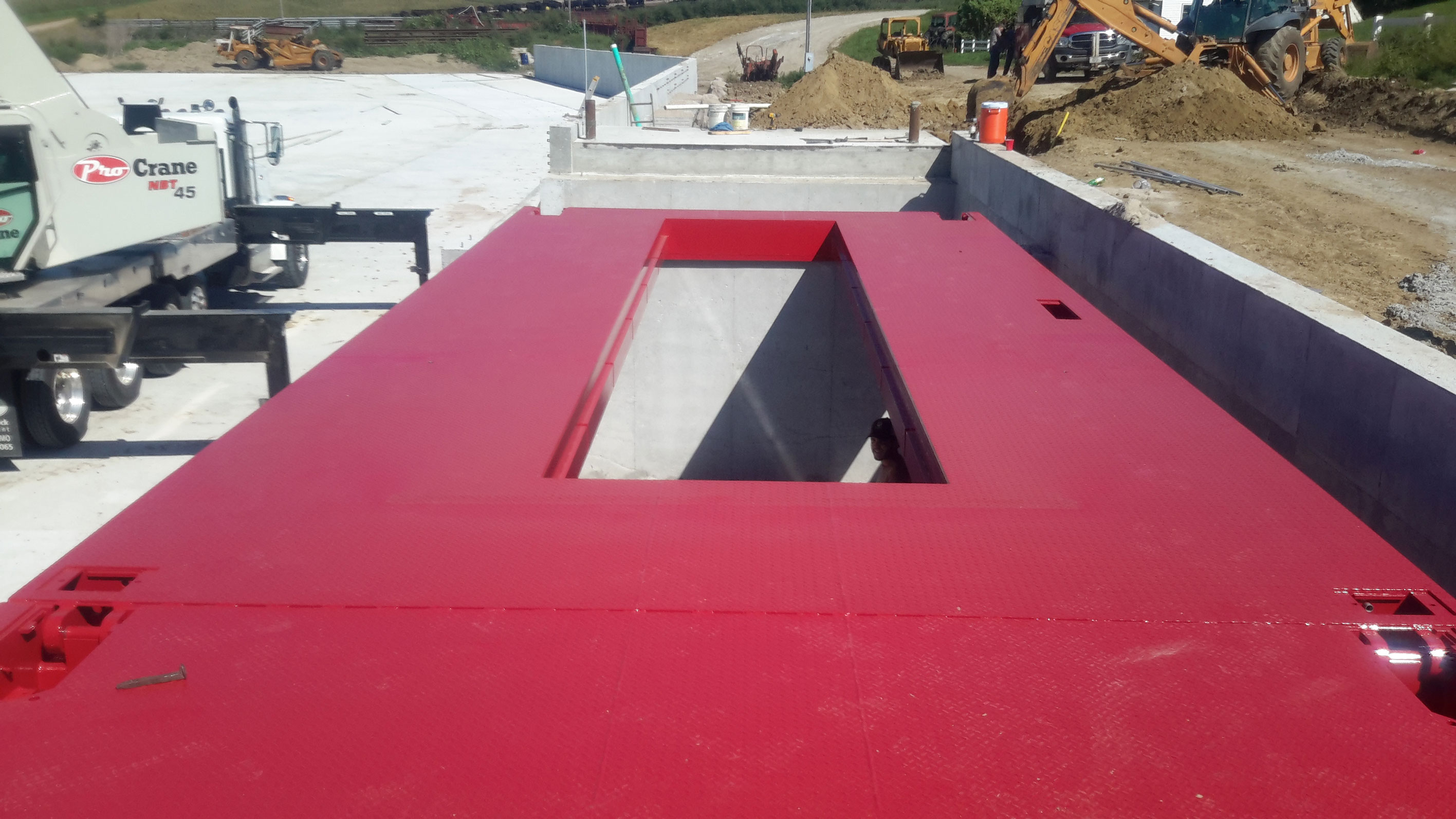 Scales Sales and Service implemented the construction and installation of this Rice Lake steel deck OTR 80'x14' with a grain dump in scale – Clarkson, NE